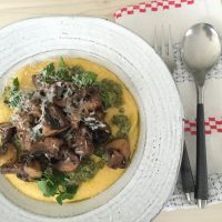 Lemony mushroom ragu on oozy polenta with kale pesto